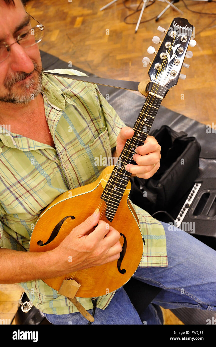 Electric mandolin, played by Nigel Woodhouse.The electric mandolin is an instrument tuned and played as the mandolin - Stock Image