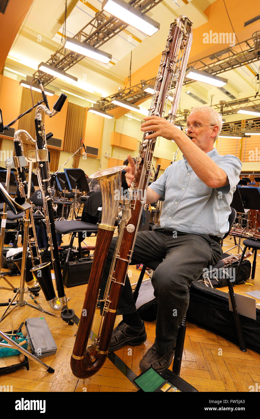Alan Andrews, clarinettist and instrument maker, playing the contrabass clarinet (the deepest member of the clarinet - Stock Image