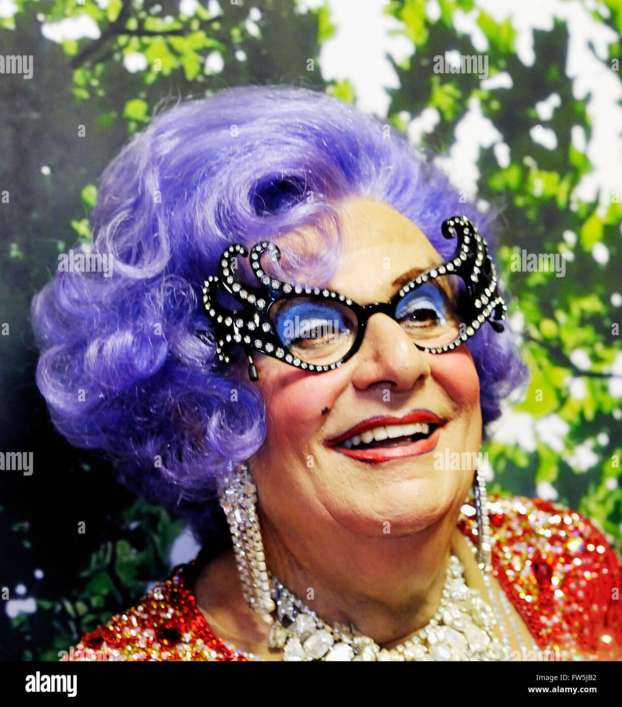 Barry Humphries, Australian actor / comedian, as Dame Edna Everage, Australian super-star housewife, after a concert - Stock Image