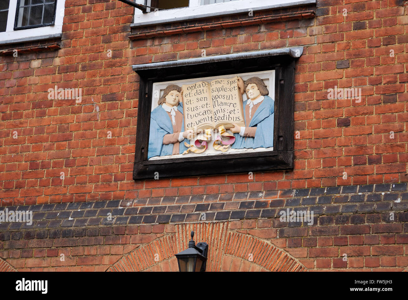 Latin plaque on wall at Eton College, Berkshire, invoking God to grant wisdom and learning - Stock Image