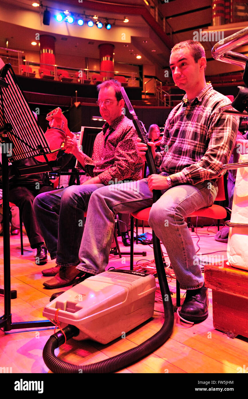 vacuum cleaners on stage in Birmingham Symphony Hall; as solo instruments in Malcolm Arnold's 'Grand Grand - Stock Image