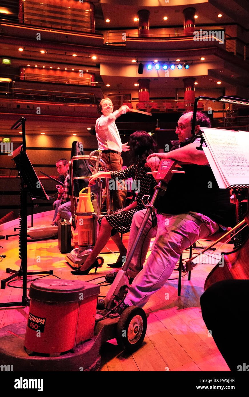 floor polisher and vacuum cleaners on stage in Birmingham Symphony Hall; as solo instruments in Malcolm Arnold's - Stock Image