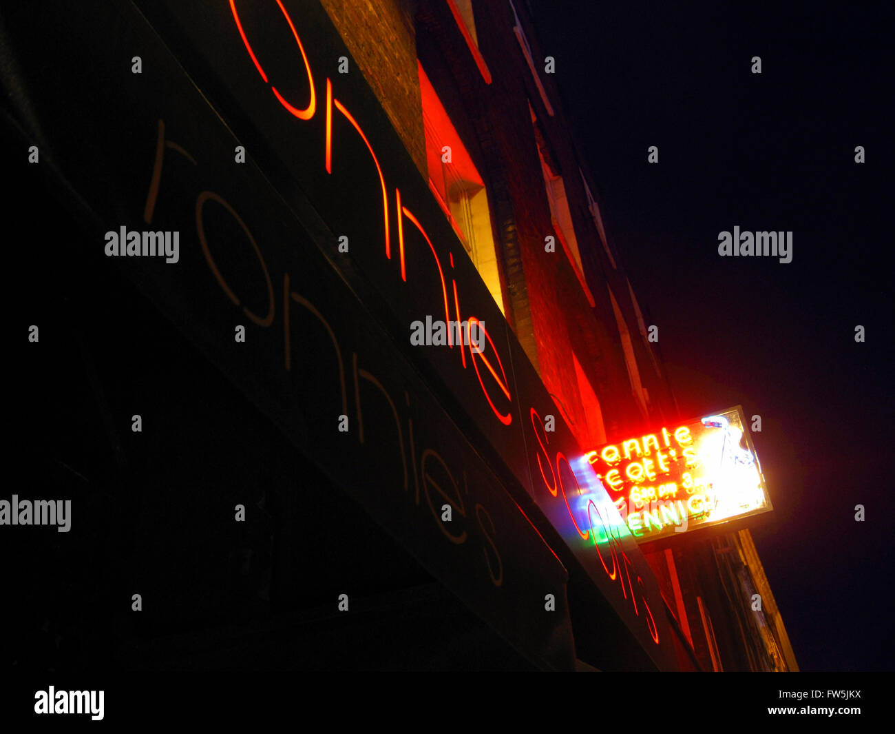 neon signs outside Ronnie Scott's jazz club, 47 Frith Street, London W1D 4HT; Soho; London's leading international - Stock Image