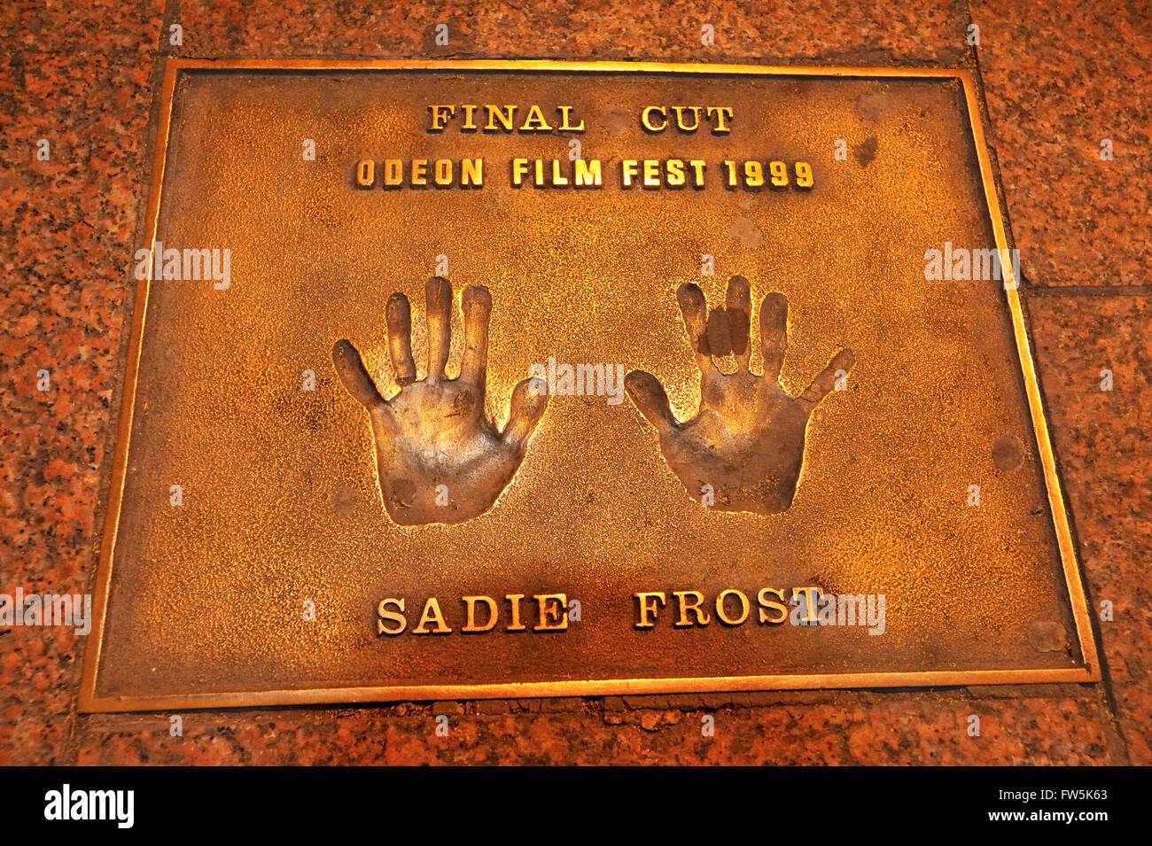 bronze plaque of handprint set into the pavement of Leicester Square: of Sadie Frost: 'Final Cut' Odeon - Stock Image