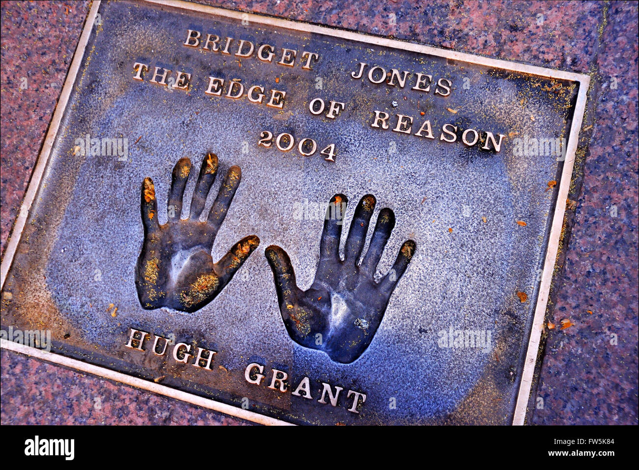 Hugh Grant bronze plaque of handprint set into the pavement of Leicester Square: of Hugh Grant: 'Bridget Jones', - Stock Image