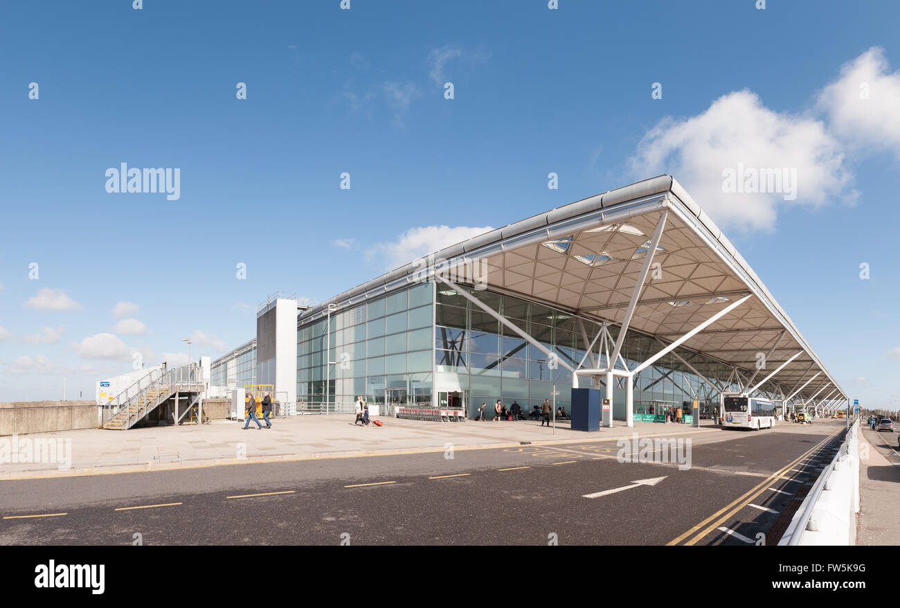 Airport arrivals departures international flights Stansted airport drop off entrance exit interesting design Norman - Stock Image