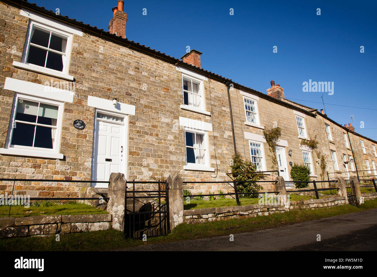 Row of country houses in sunshine - Stock Image