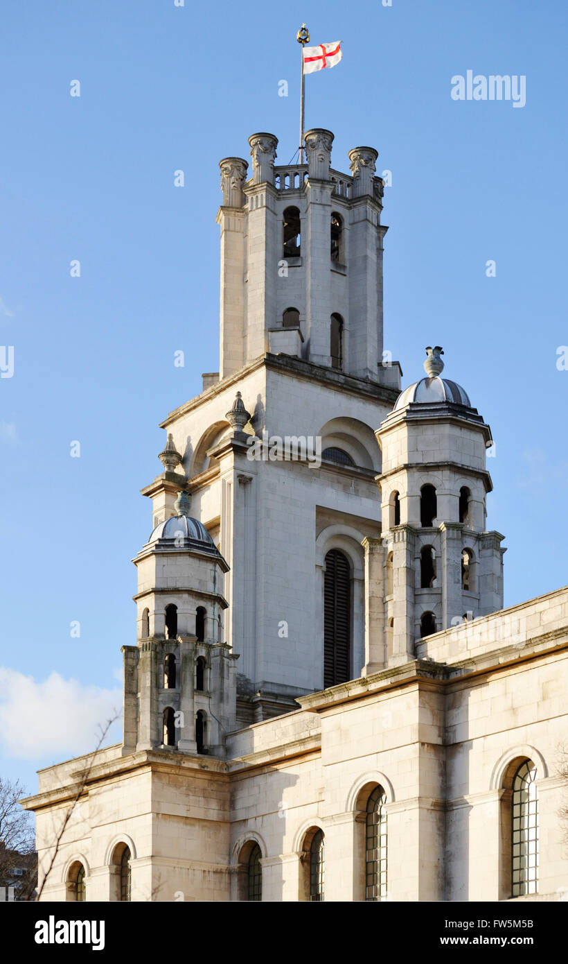 Tower of St George in the East, modern glass front over old structure. St George in the East on Cannon Street Road - Stock Image