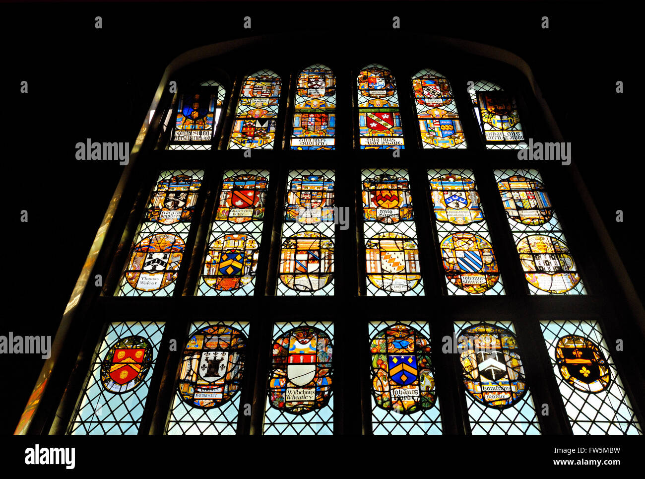 the great window of Middle Temple Hall, London Inns of Court, dated 1570, with shields of nobility including Thomas - Stock Image