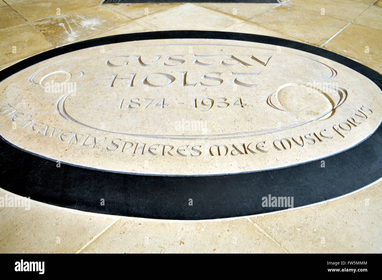 New, replacement, floor plaque in Chichester Cathedral to English composer Gustav Holst, 1874-1934. The 75th Anniversary - Stock Image