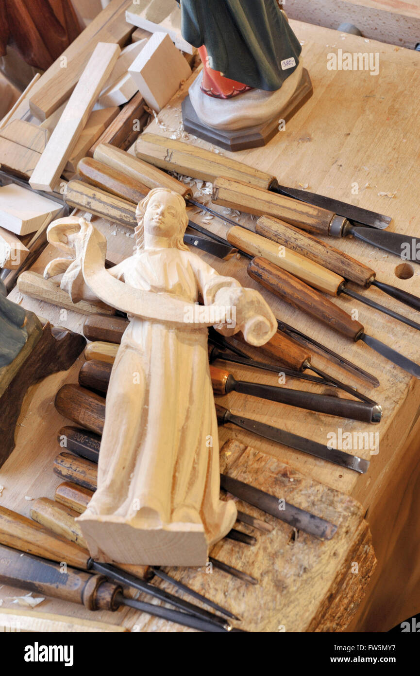 wood carving of an angel bearing a scroll, in Oberammergau, Bavaria. Carving is one of the local specialities: the - Stock Image