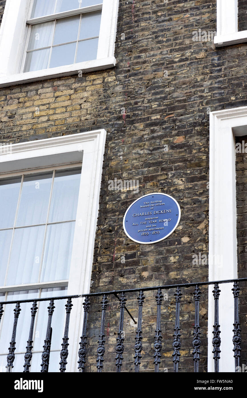 blue plaque on the offices of English novelist Charles Dickens, on the corner of Wellington St and Tavistock St, - Stock Image