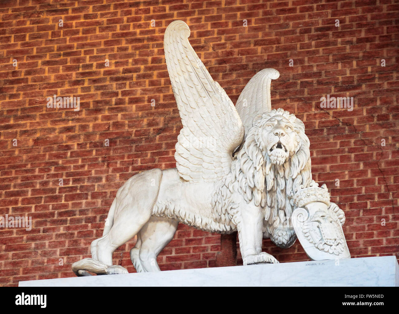 Titian monument lion; a Venetian winged lion at the very top of the Titian monument, in the church of the Frari, - Stock Image