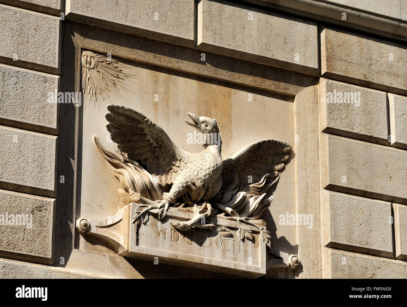 Phoenix, La Fenice. Stone carved phoenix on the wall of the new opera house La Fenice in Venice, reopened 2003, - Stock Image