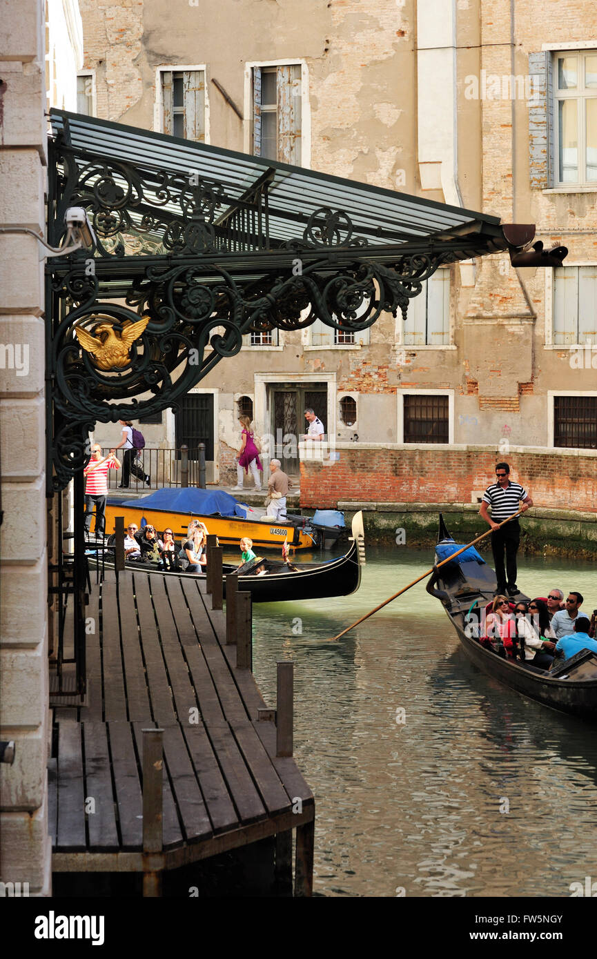 La Fenice, gondolas take tourists around canals to see the new Venice opera house, reopened 2003 after arson, rebuilt - Stock Image