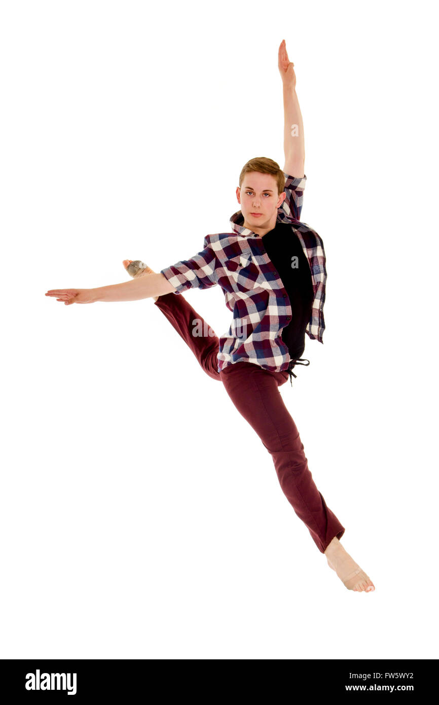 Skilled Male Lyrical or Contemporary Dancer Leaps in a Jete with a bit of attitude - Stock Image