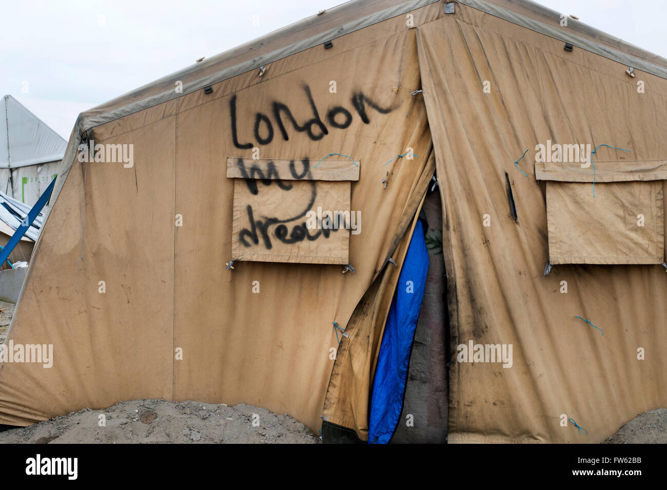 France, Calais. Refugee camp - the so-called Jungle. Writing on a tent saying 'London my dream'. - Stock Image