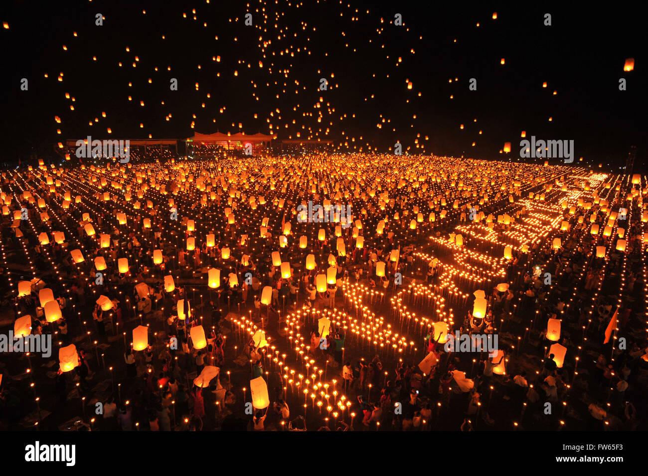 People letting sky lanterns rise, World Peace Festival of the Dhammakaya Foundation, Dawei, Tanintharyi Region, - Stock Image