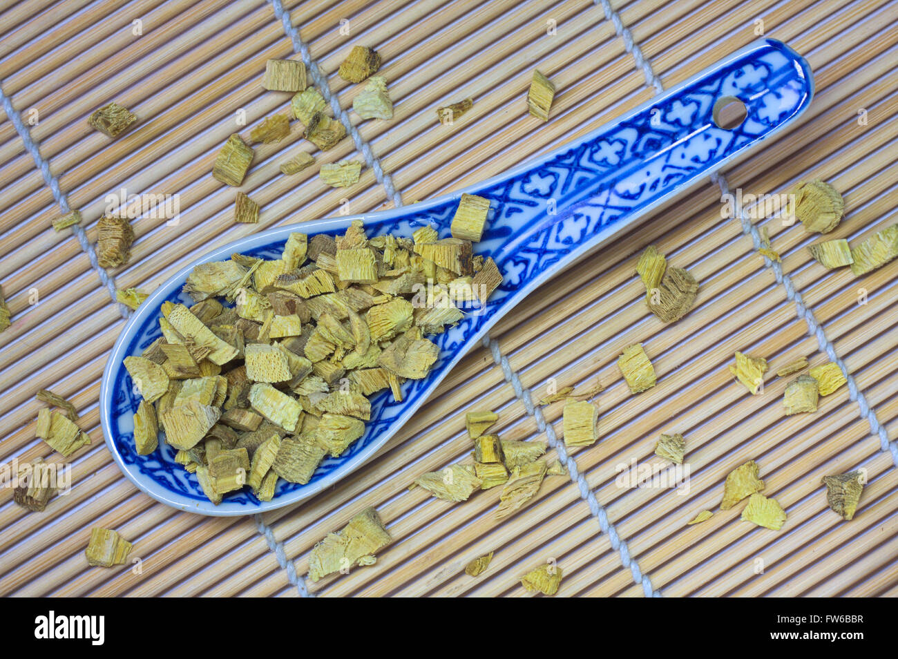 Dried liquorice on a spoon - Stock Image