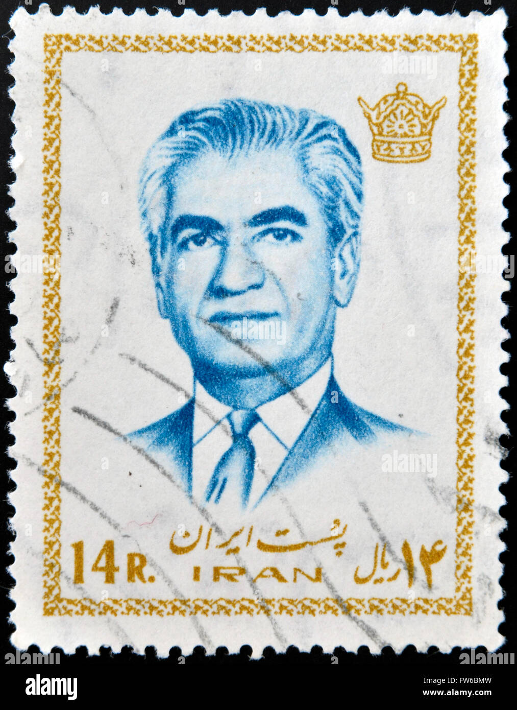 IRAN - CIRCA 1972: A stamp featuring Mohammad Reza Pahlavi, the last Shah before the 1979 Iranian revolution, circa - Stock Image