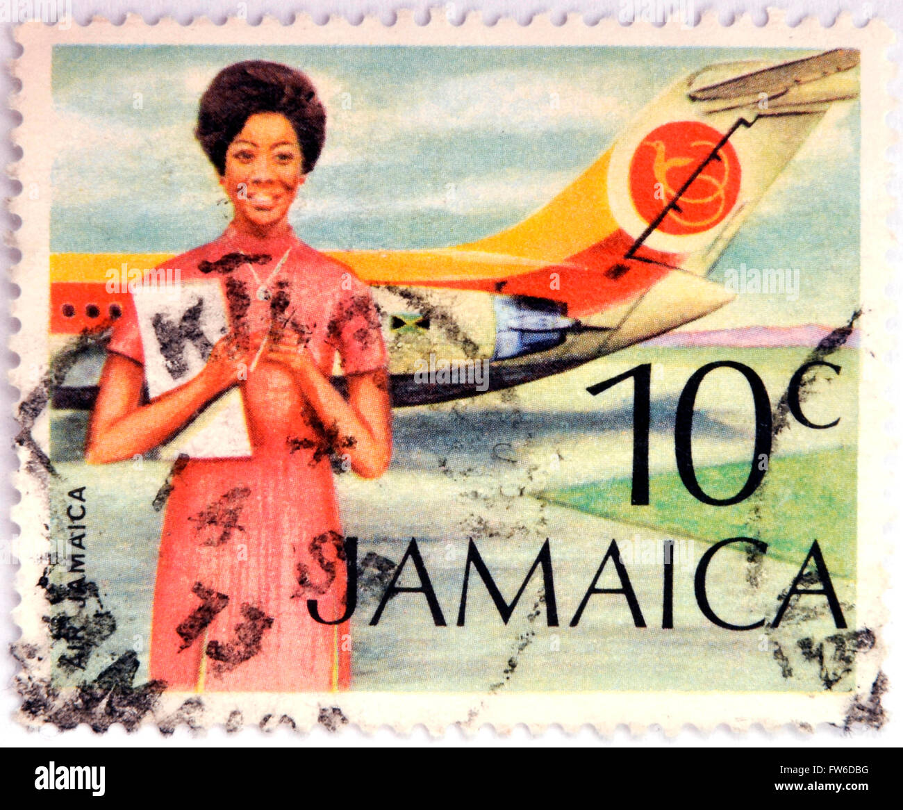 JAMAICA - CIRCA 1972: Stamp printed in Jamaica shows A Flight Attendant Standing In Front Of An Air Jamaica Airplane, - Stock Image