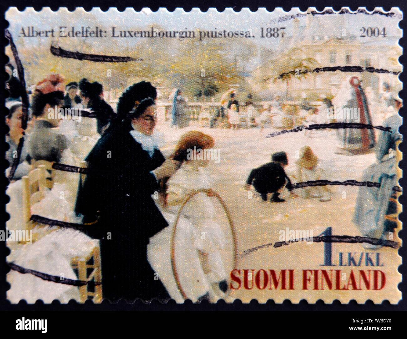 FINLAND - CIRCA 2004: stamp printed in Finland shows women in Luxembourg Garden, picture of Albert Edelfelt, circa 2004 Stock Photo