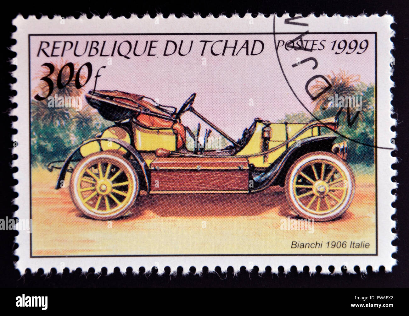 CHAD - CIRCA 1999: A stamp printed in Chad shows vintage car, circa 1999 - Stock Image