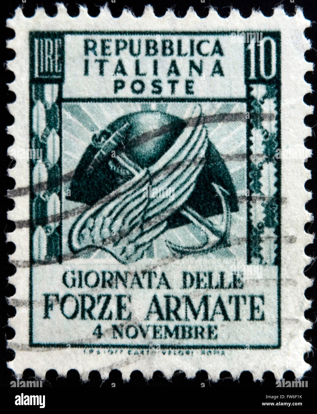 ITALY - CIRCA 1952: stamp printed in Italy shows Symbols of army