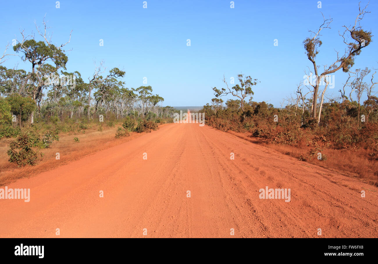 A straight section of red dirt outback road on the Cape York Peninsula with corrugation. Stock Photo
