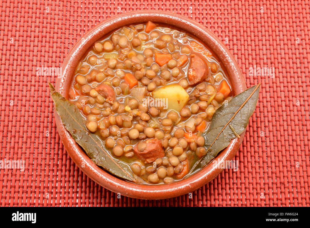 Brown lentil stew in bowl with vegetable Stock Photo