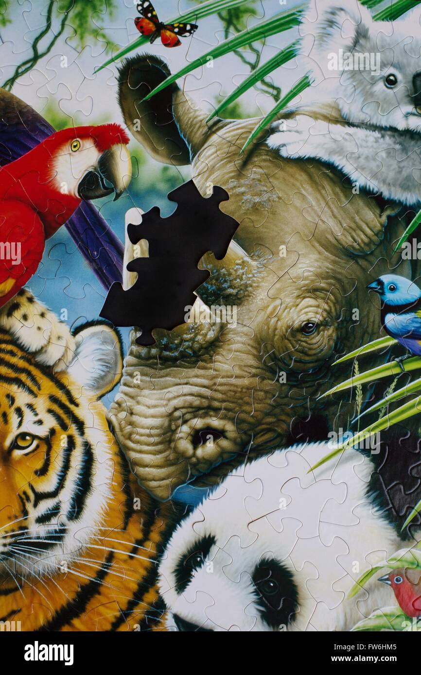 A puzzle of a wildlife scene with the rhino horn missing. - Stock Image