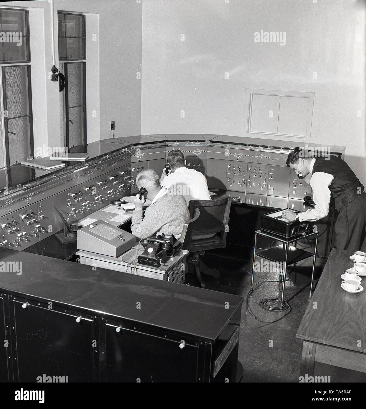 1950s historical, working in a control room at airport Jan Smuts, South Africa. - Stock Image