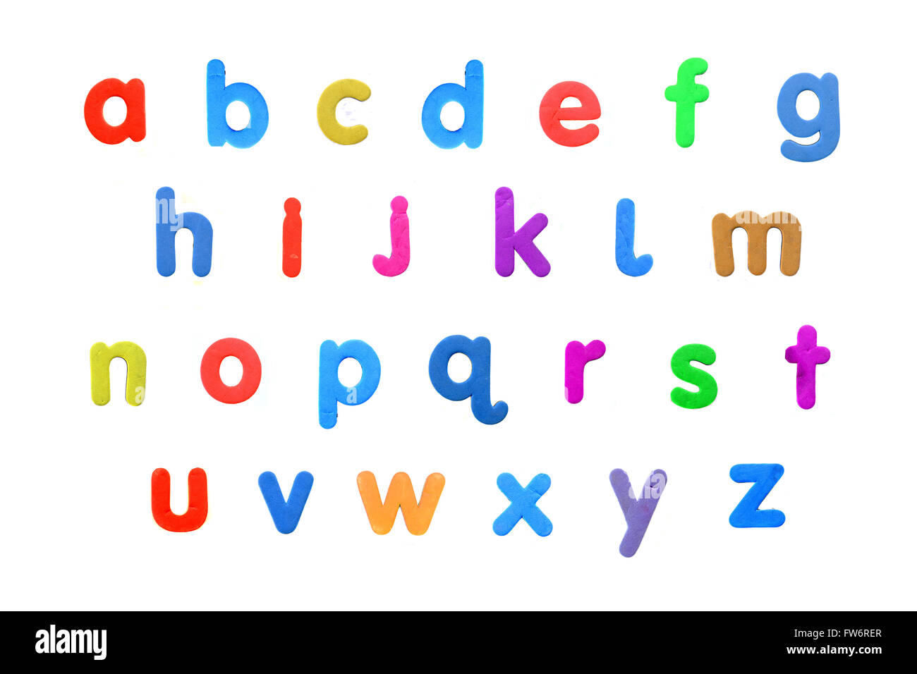 an alphabet created from fridge magnet letters against a white background
