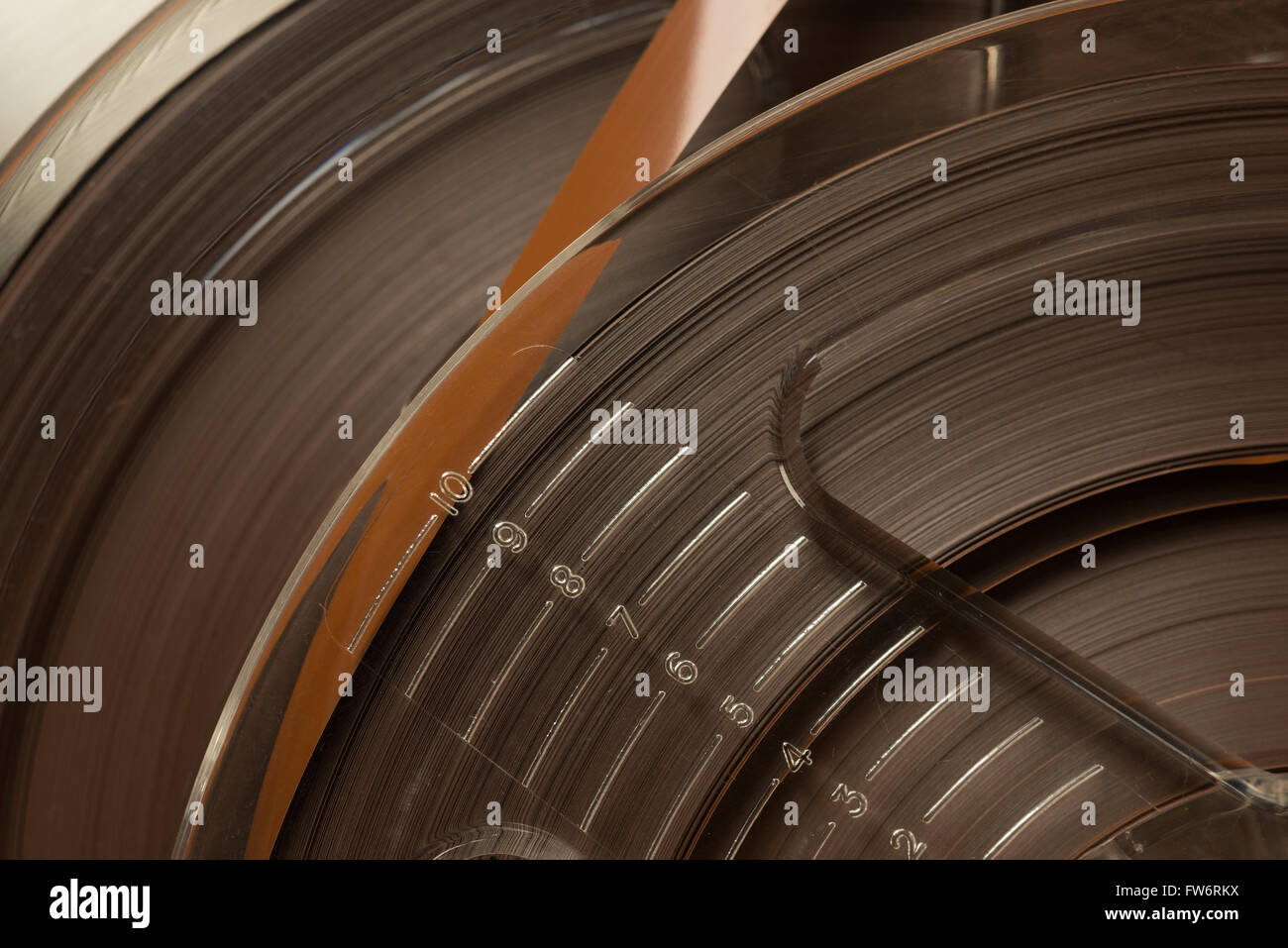 Analogue old fashioned not digital magnetic reel to reel tape sound audio recording wound up on reels - Stock Image