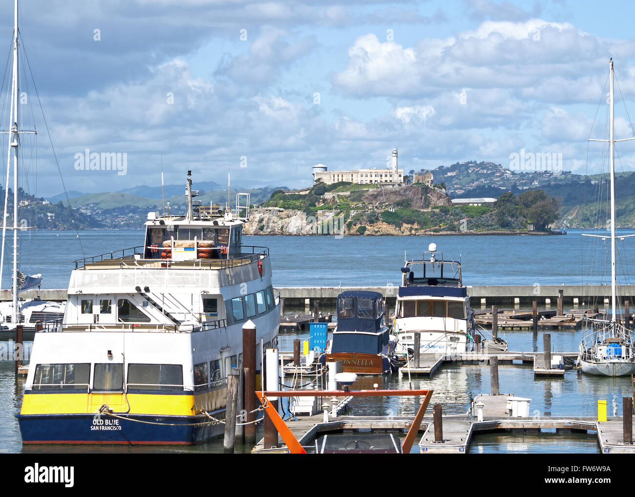 Alcatraz Island  with yacht marina in foreground in San Francisco Bay California USA - Stock Image