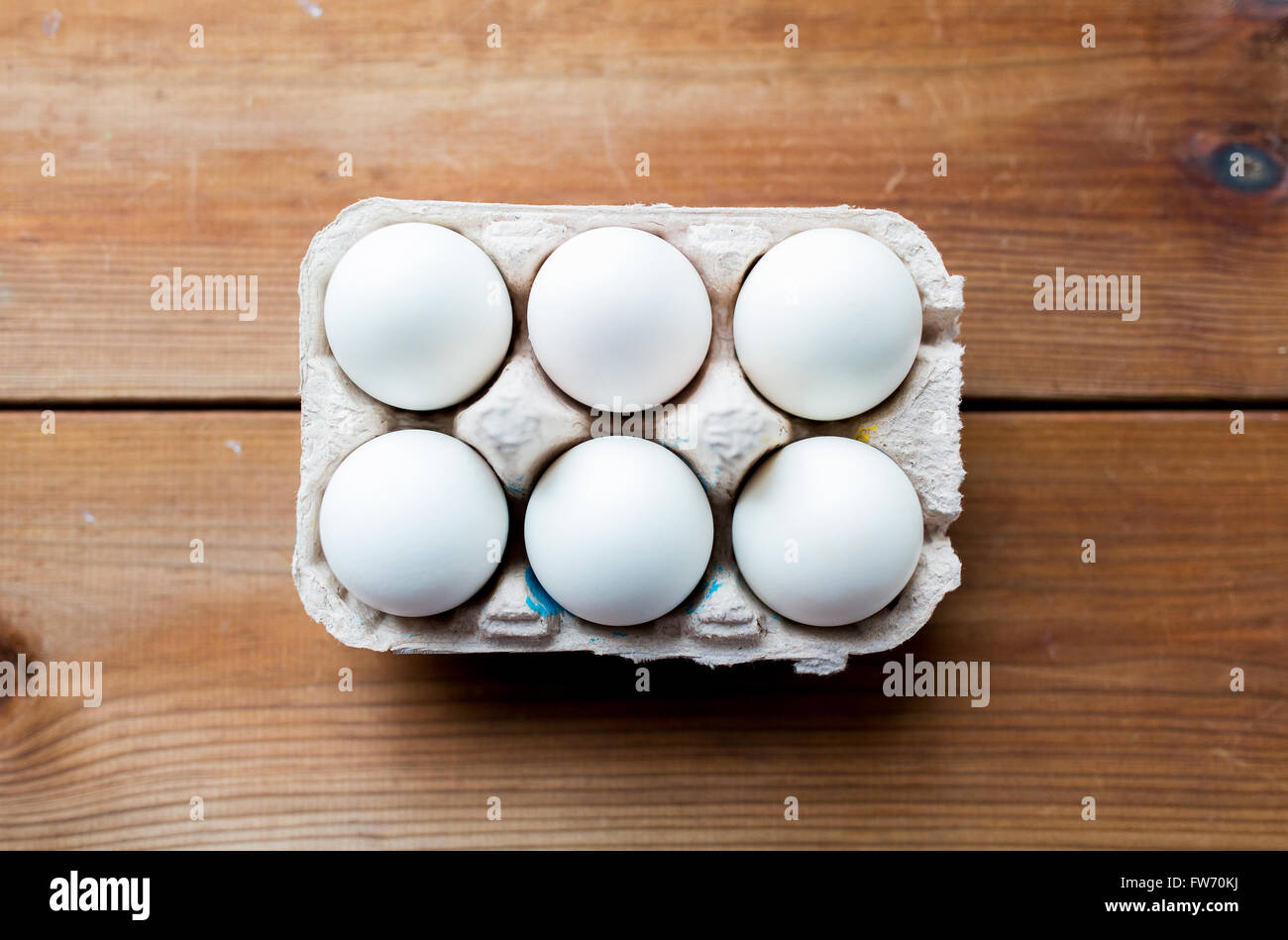 close up of white eggs in egg box or carton Stock Photo