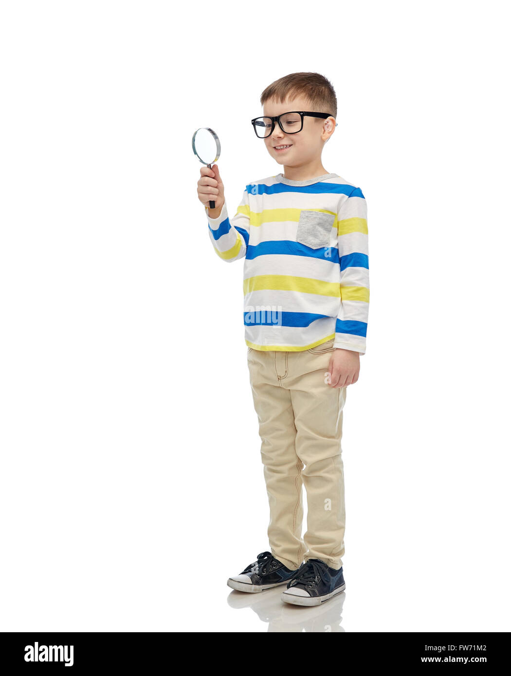 little boy in eyeglasses with magnifying glass - Stock Image