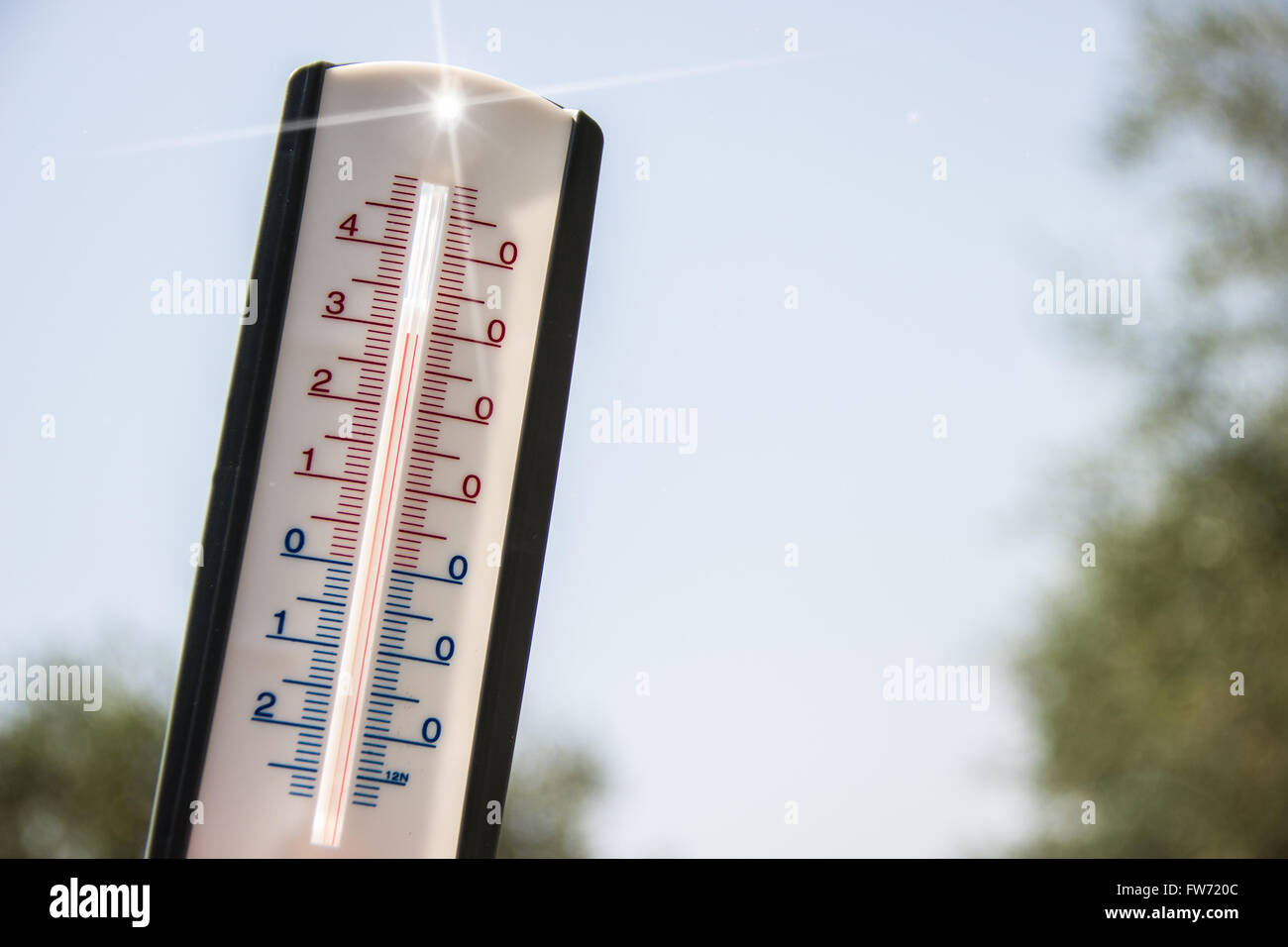 thermometer pointing to the sky to symbolize the heat of summer - Stock Image