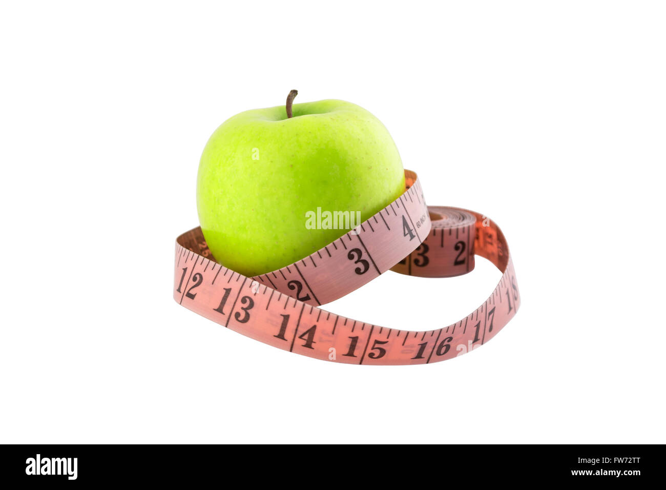 Green apple with tailor meter isolated on white background with clipping path. - Stock Image