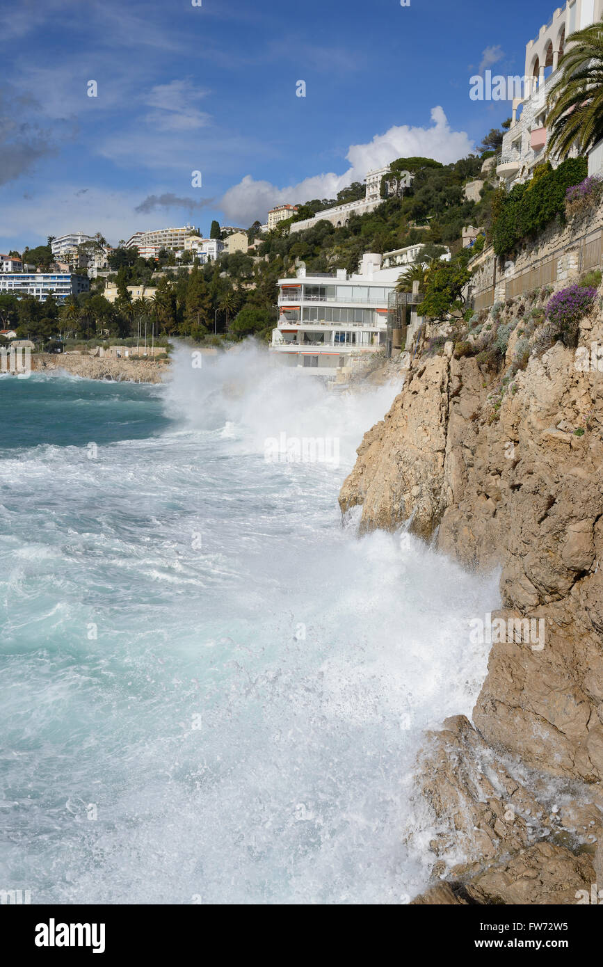 SURF BREAKING ON A LIMESTONE CLIFF. Nice, Alpes-Maritimes, French Riviera, France. - Stock Image