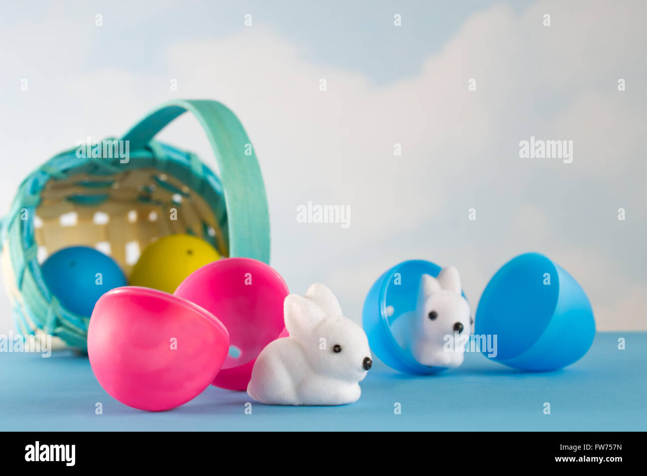 Easter Basket Filled With Plastic Eggs Rolls Over And Little White