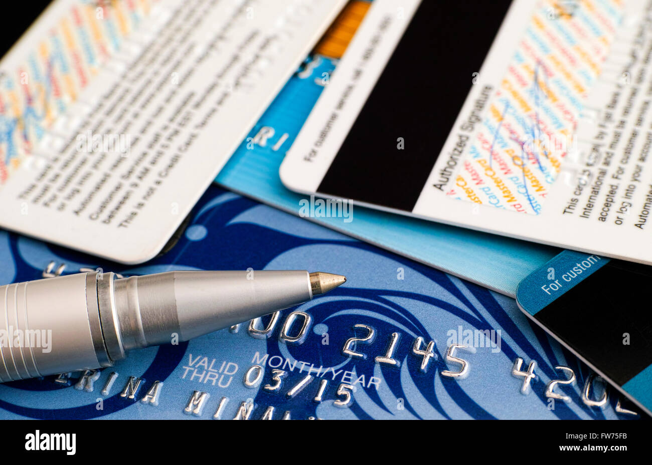 Tambov, Russian Federation - March 31, 2015 Credit cards with ballpoint pen. Studio shot. Stock Photo