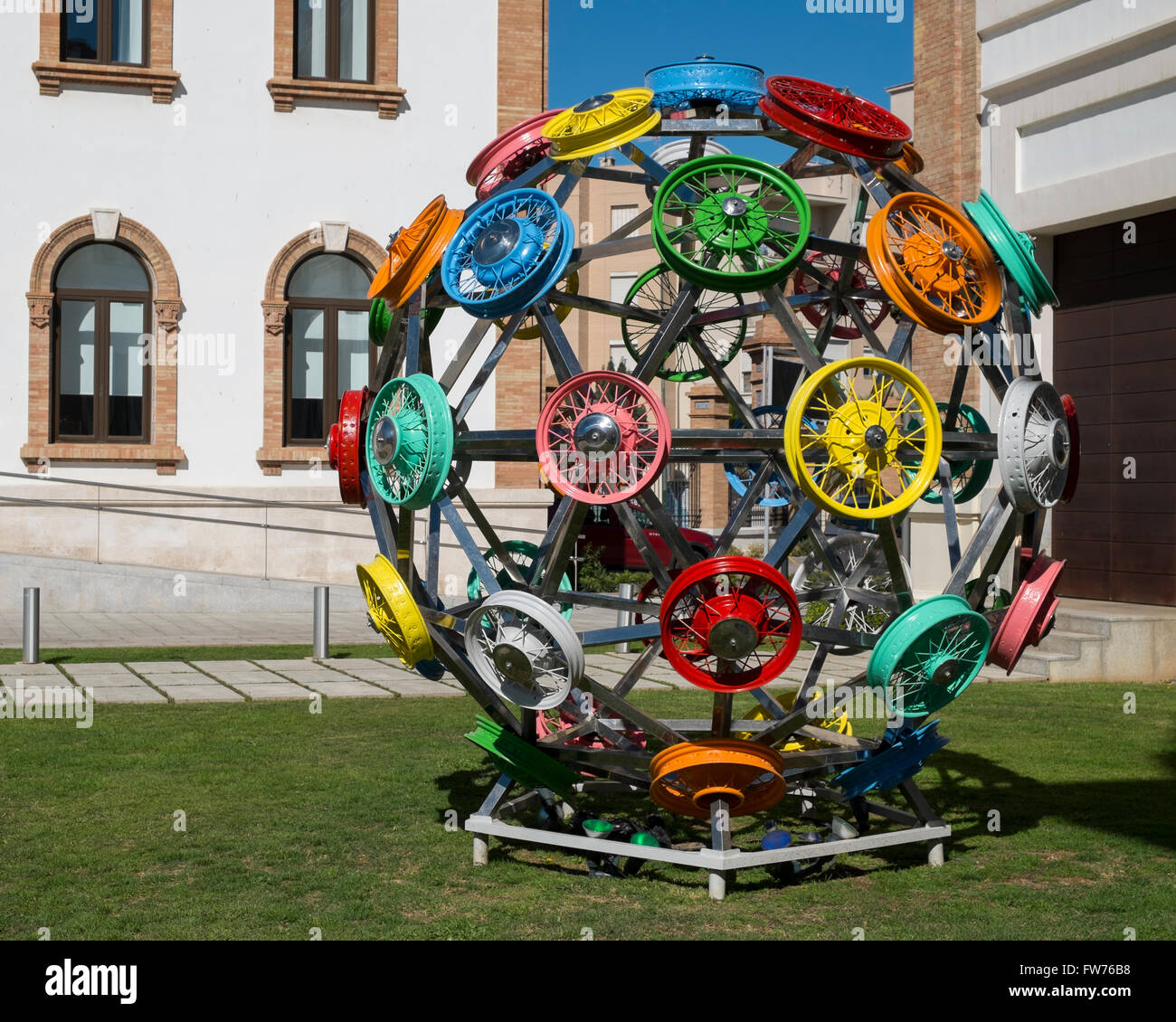Sculpture of wheel rims at  automobile museum of Málaga - Stock Image