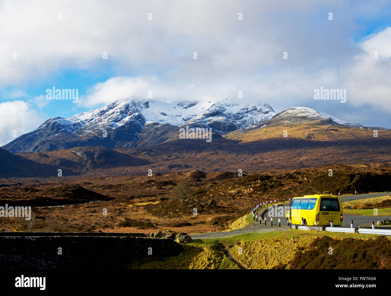 Bus on A863 at Sligachan, with Cuillin mountains in the distance, Isle of Skye, Inner Hebrides, Scotland UK - Stock Image