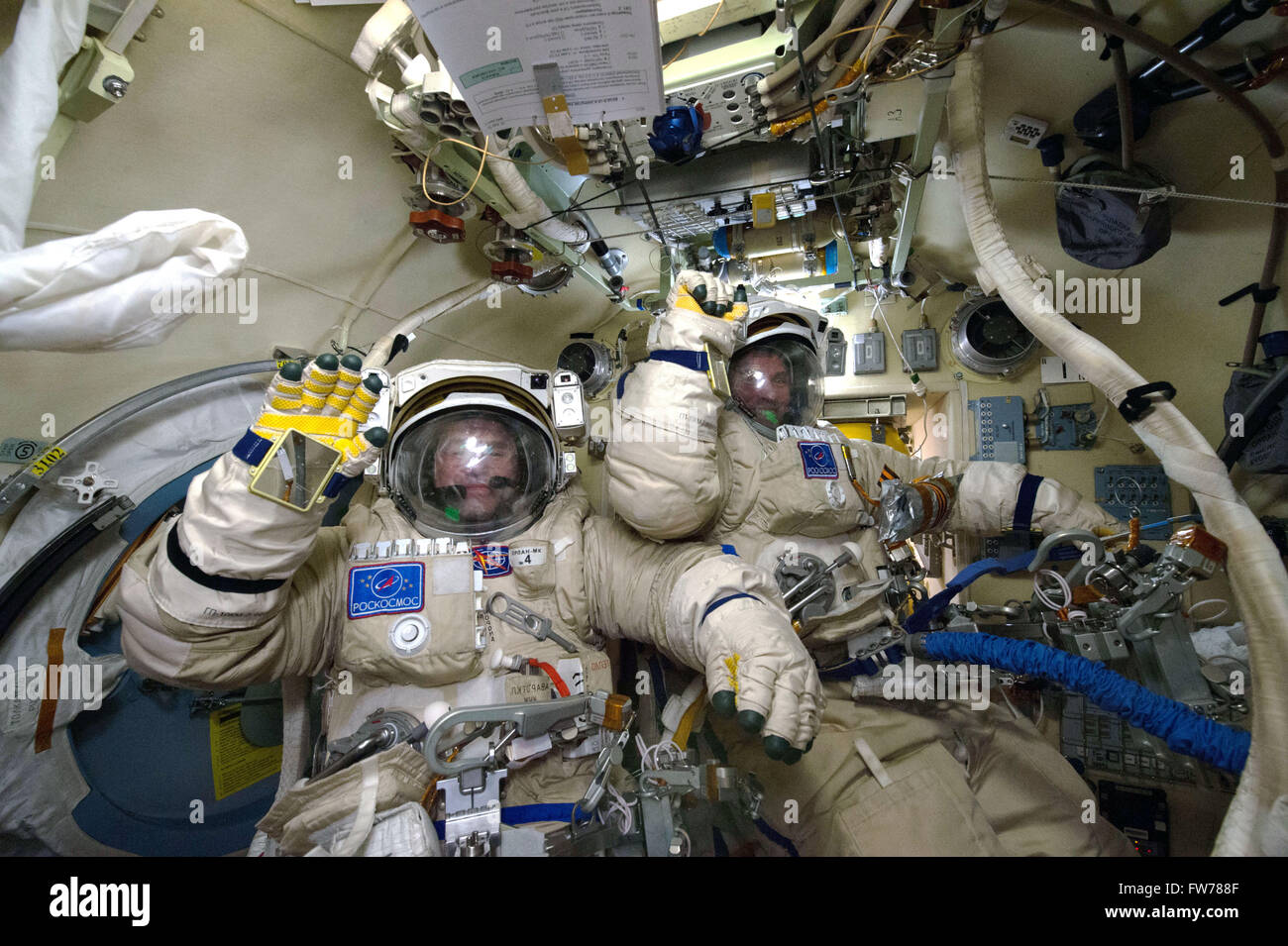 Russian cosmonauts Yuri Malenchenko and Sergei Volkov in their Orlan spacesuits before a spacewalk aboard the International - Stock Image