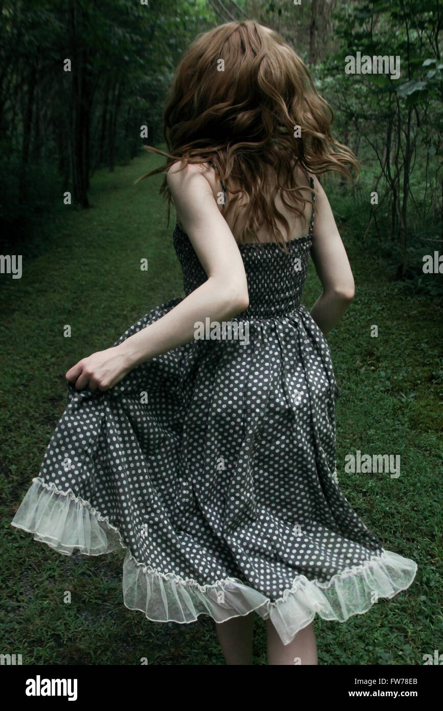 Woman running away - Stock Image