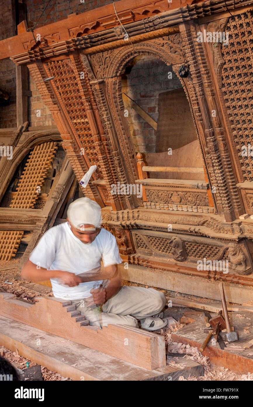 Bhaktapur, Nepal.  Woodworker at Work, Making a Door Frame. Stock Photo