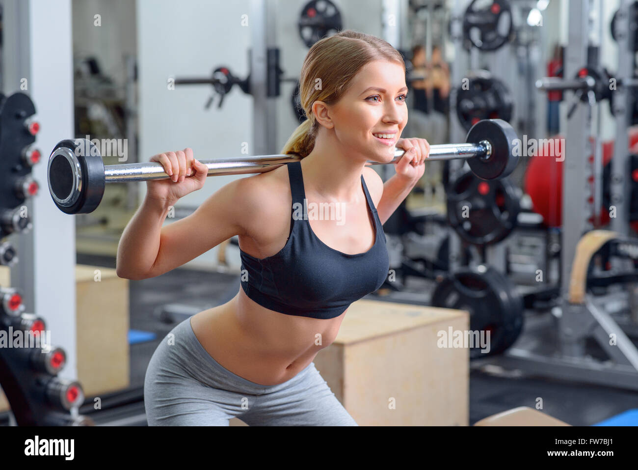 Nice girl holding barbell - Stock Image