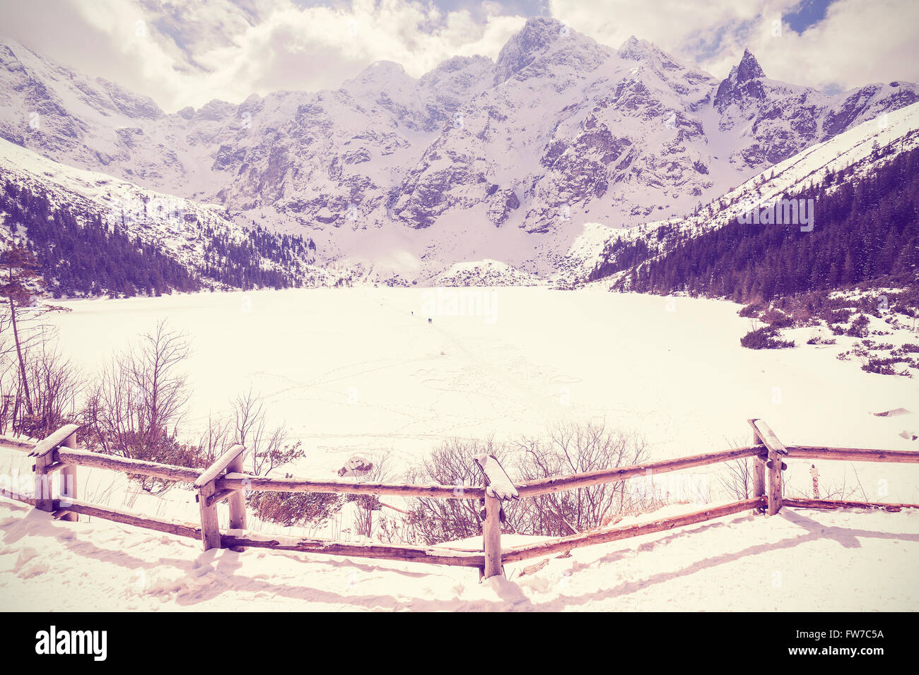Vintage stylized frozen lake Morskie Oko in Tatra Mountains, most popular mountain lake in Poland. - Stock Image