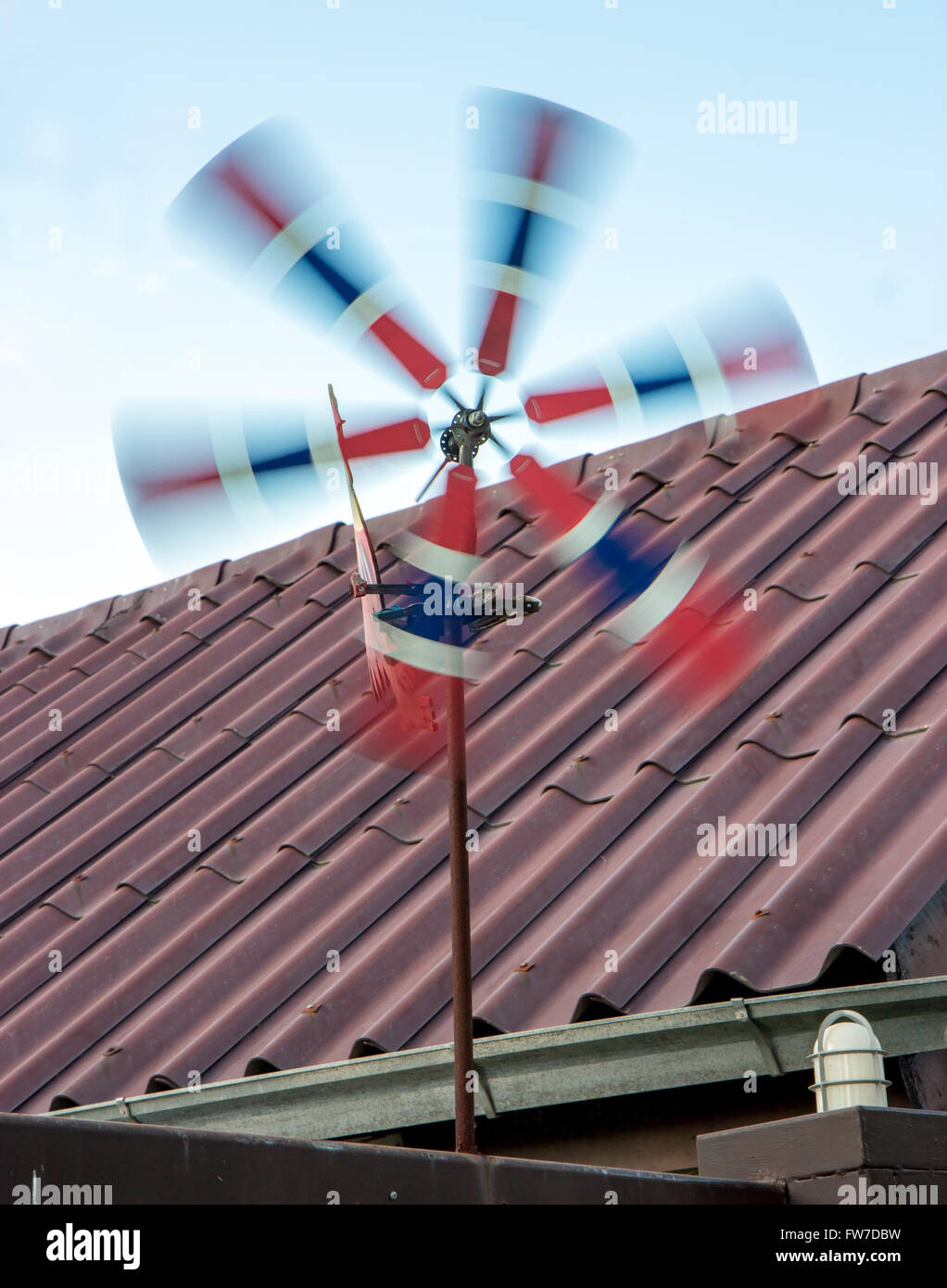 pinwheel in the national colors spins in the wind - Stock Image